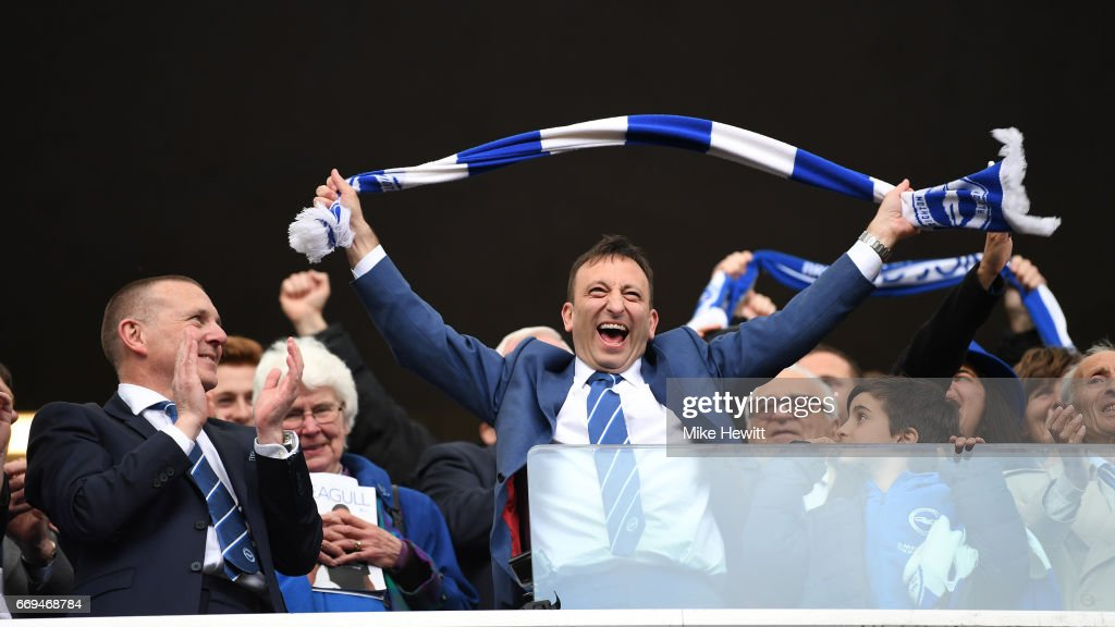Brighton CEO Paul Barber (L) watches Chairman Tony Bloom celelebrate at the end of the Sky Bet Championship match between Brighton & Hove Albion and Wigan Athletic at Amex Stadium on April 17, 2017 in Brighton, England.