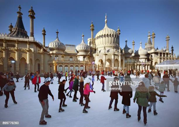 brighton christmas skaters - ice rink stock photos and pictures