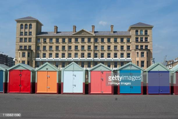 Brighton East Sussex UK 21/5/10 Traditional brightly coloured beach huts on the paved promenade close to the sea on the way to Hove Brighton East...