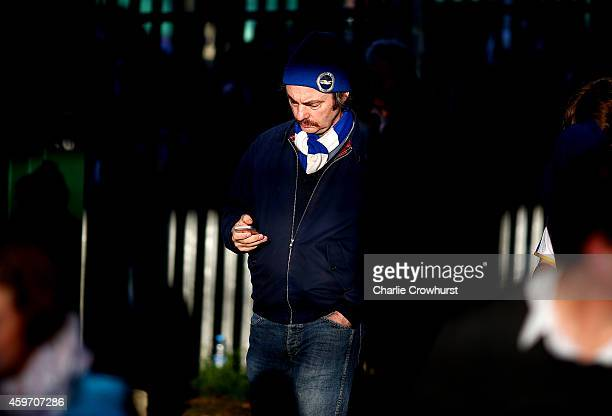 Brighton fan makes his way to the ground prior to the Sky Bet Championship match between Brighton Hove Albion and Fulham at The Amex Stadium on...