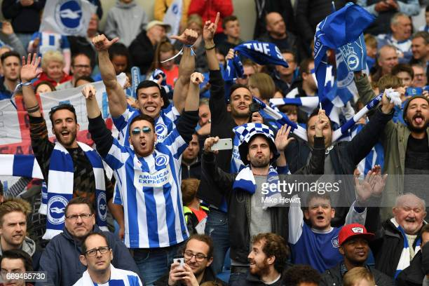 Brighton fans celebrate during the Sky Bet Championship match between Brighton Hove Albion and Wigan Athletic at Amex Stadium on April 17 2017 in...