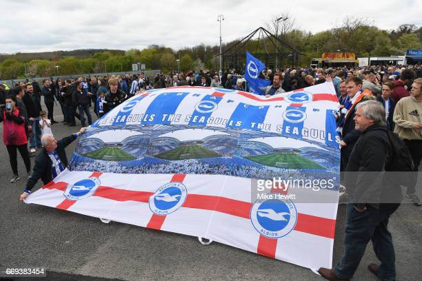 Brighton fans display a flag outside the ground prior to the Sky Bet Championship match between Brighton and Hove Albion and Wigan Athletic at Amex...