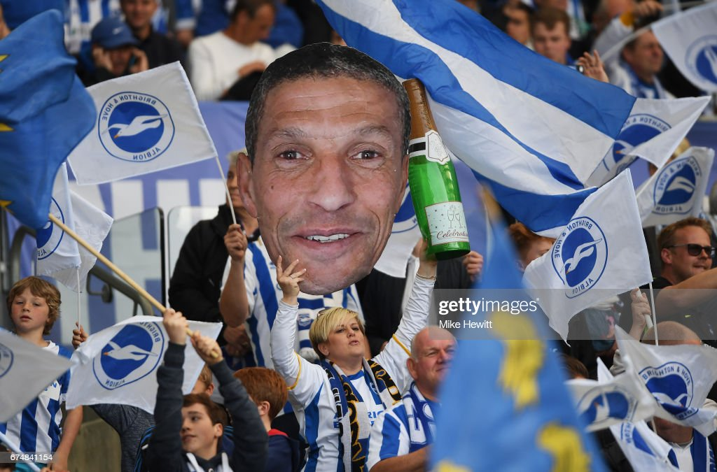 Brighton fans hold a cardboard cut-out of Chris Hughton, manager of Brighton and Hove Albion during the Sky Bet Championship match between Brighton & Hove Albion and Bristol City at Amex Stadium on April 29, 2017 in Brighton, England.