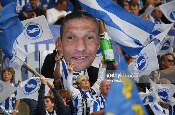 Brighton fans hold a cardboard cutout of Chris Hughton manager of Brighton and Hove Albion during the Sky Bet Championship match between Brighton...
