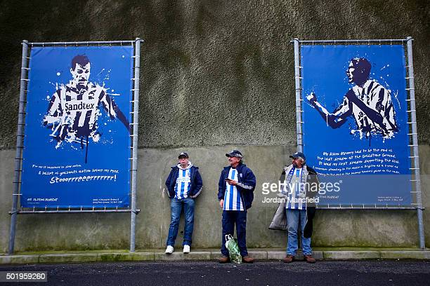 Brighton fans look on outside the ground ahead of the Sky Bet Championship match between Brighton and Hove Albion and Middlesbrough on December 19...
