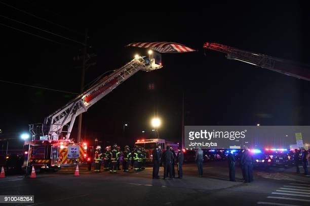 Brighton Fire and Brighton PD all gathered to pay their respects to fallen Adams County Sheriff's deputy A flag hung down from Truck 53 and Tower 51...