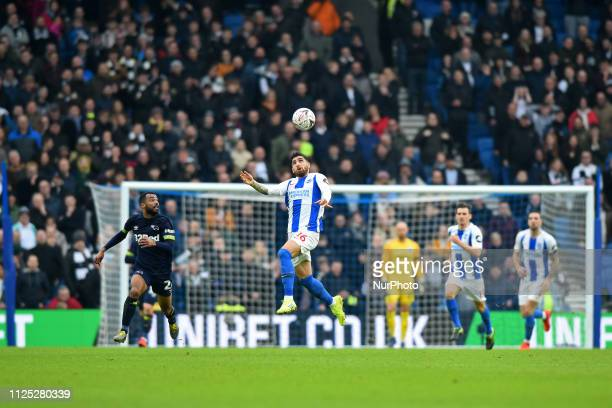 Brighton forward Alireza Jahanbakhsh heads away from Derby County defender Ashley Cole during the Emirates FA Cup 5th round tie between Brighton and...