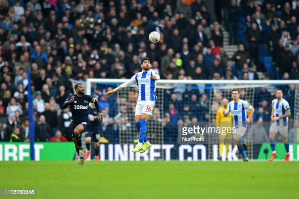 Brighton forward Alireza Jahanbakhsh heads the ball from Derby County defender Ashley Cole during the Emirates FA Cup 5th round tie between Brighton...