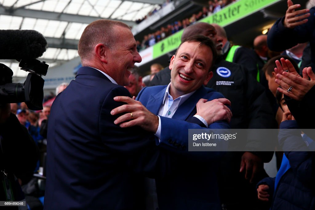 Brighton & Hove Albion CEO Paul Barber and Chairman Tony Bloom celebrate with the players in the stands after victory in the Sky Bet Championship match between Brighton & Hove Albion and Wigan Athletic at Amex Stadium on April 17, 2017 in Brighton, England.