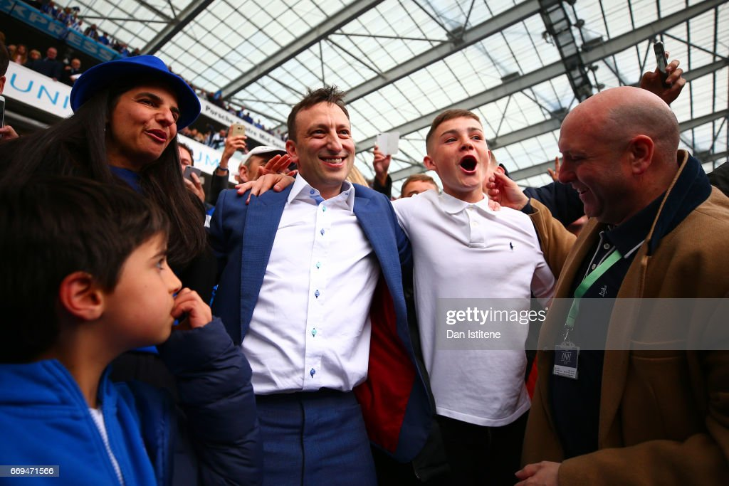 Brighton & Hove Albion Chairman Tony Bloom celebrates with family, including wife Linda Bloom, and the players in the stands after victory in the Sky Bet Championship match between Brighton & Hove Albion and Wigan Athletic at Amex Stadium on April 17, 2017 in Brighton, England.