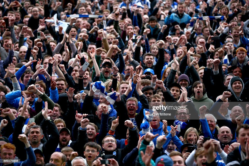 Brighton & Hove Albion fans celebrate on the pitch after their team's victory in the Sky Bet Championship match between Brighton & Hove Albion and Wigan Athletic at Amex Stadium on April 17, 2017 in Brighton, England.