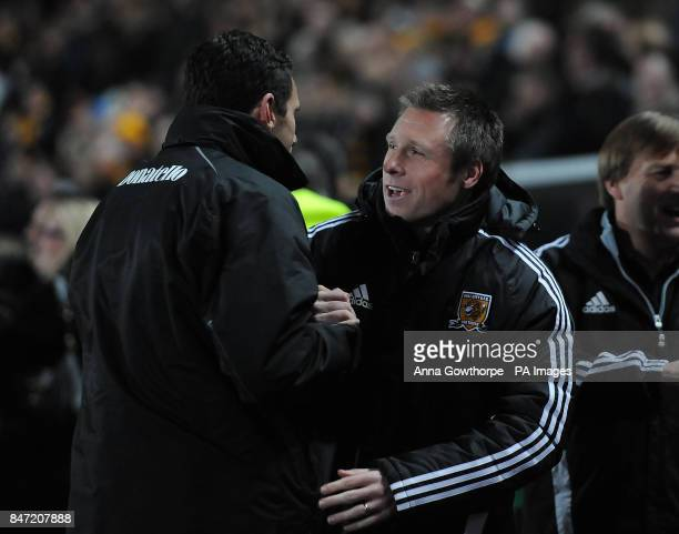 Brighton Hove Albion manager Gus Poyet and Hull City manager Nick Barmby meet on the touchline prior to the npower Football League Championship match...