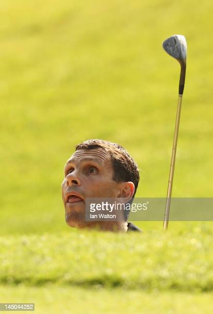 Brighton & Hove Albion manager Gus Poyet hits to a green during the Pro-Am round prior to the BMW PGA Championship on the West Course at the...