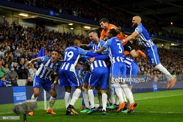 Brighton Hove Albion players celebrate Pascal Gross scoring the opening goal during the Premier League match between Brighton and Hove Albion and...