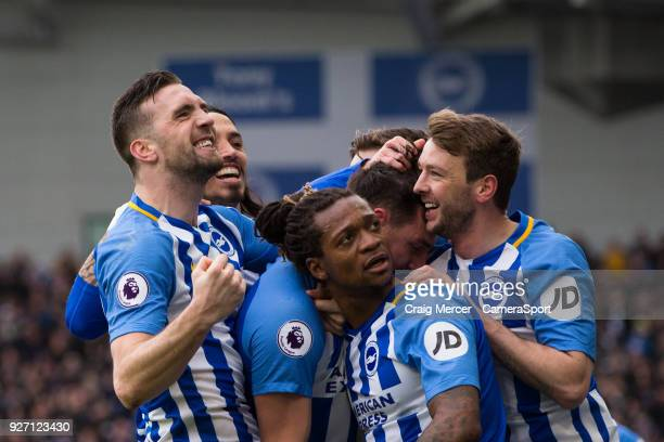 Brighton Hove Albion players celebrate their side's opening goal during the Premier League match between Brighton and Hove Albion and Arsenal at Amex...