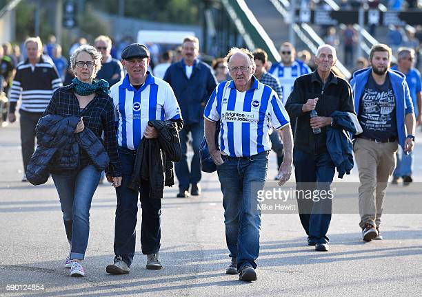 Brighton Hove Albion supporters make their way to the stadium prior to the Sky Bet Championship match between Brighton Hove Albion and Rotherham...