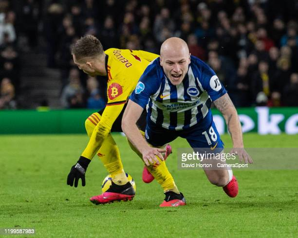 Brighton Hove Albion's Aaron Mooy fails to hold off the challenge from Watford's Gerard Deulofeu during the Premier League match between Brighton...