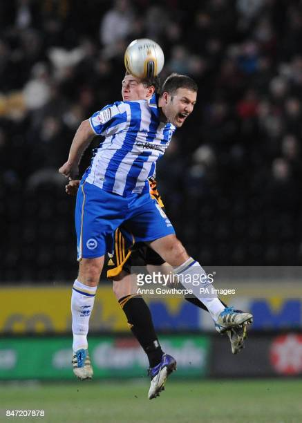 Brighton Hove Albion's Alan Navarro and Hull City's Corry Evans battle for the ball during the npower Football League Championship match at the KC...