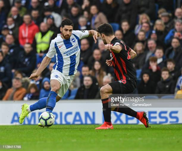 Brighton Hove Albion's Alireza Jahanbakhsh under pressure from Huddersfield Town's Christopher Schindler during the Premier League match between...