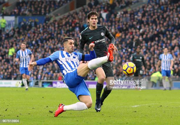 Brighton Hove Albion's Beram Kayal and Chelsea's Marcos Alonso battle for the ball during the Premier League match at the AMEX Stadium Brighton