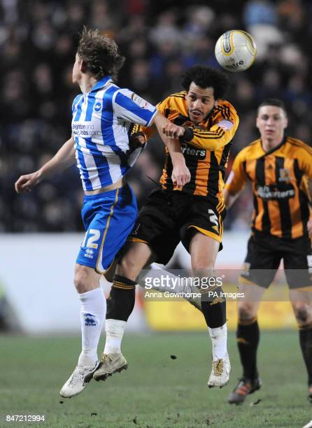 Brighton Hove Albion's Craig MackailSmith and Hull City's Liam Rosenior battle for the ball during the npower Football League Championship match at...