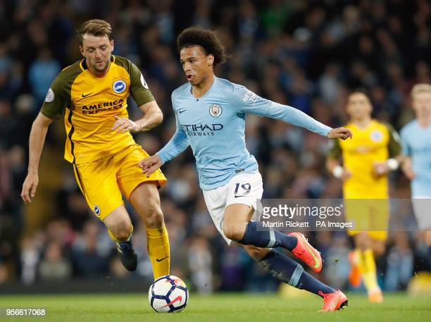 Brighton Hove Albion's Dale Stephens and Manchester City's Leroy Sane battle for the ball during the Premier League match at the Etihad Stadium...