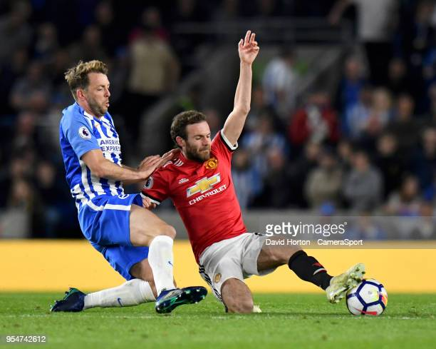 Brighton Hove Albion's Dale Stephens battles with Manchester United's Juan Mata during the Premier League match between Brighton and Hove Albion and...