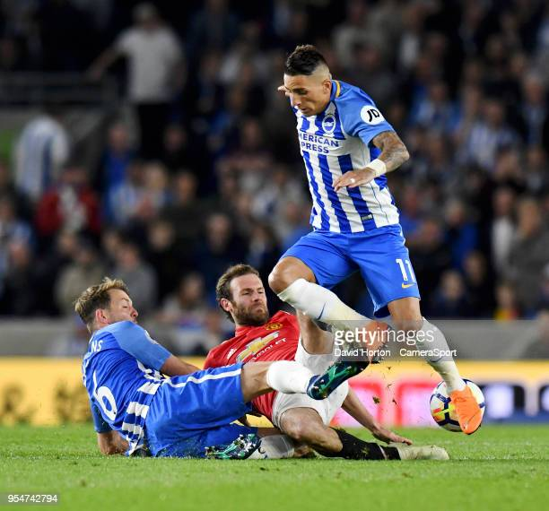 Brighton Hove Albion's Dale Stephens Manchester United's Juan Mata and Brighton Hove Albion's Anthony Knockaert battle for pocession during the...
