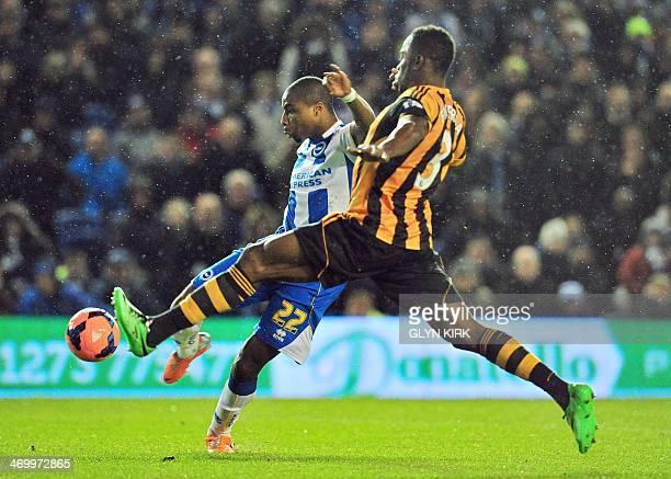 Brighton Hove Albion's English striker Jonathan Obika takes a shot past Hull City's Honduran defender Maynor Figueroa during the English FA Cup fifth...