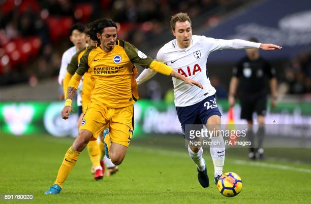 Brighton Hove Albion's Ezequiel Schelotto and Tottenham Hotspur's Christian Eriksen battle for the ball during the Premier League match at Wembley...