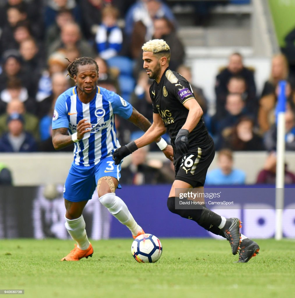 Brighton & Hove Albion's Gaetan Bong (left) battles with Leicester City's Riyad Mahrez (right) during the Premier League match between Brighton and Hove Albion and Leicester City at Amex Stadium on March 31, 2018 in Brighton, England.