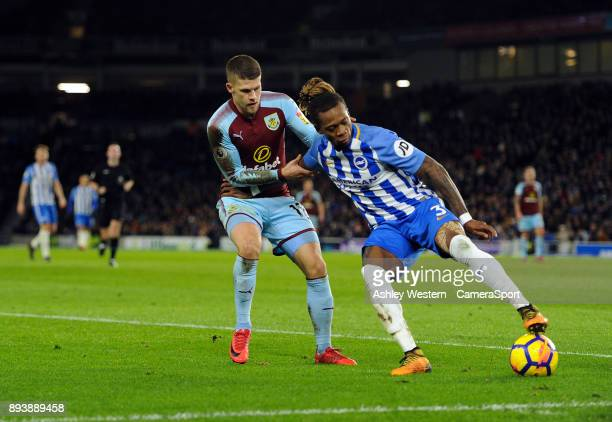 Brighton Hove Albion's Gaetan Bong holds off the challenge from Burnley's Johann Gudmundsson during the Premier League match between Brighton and...
