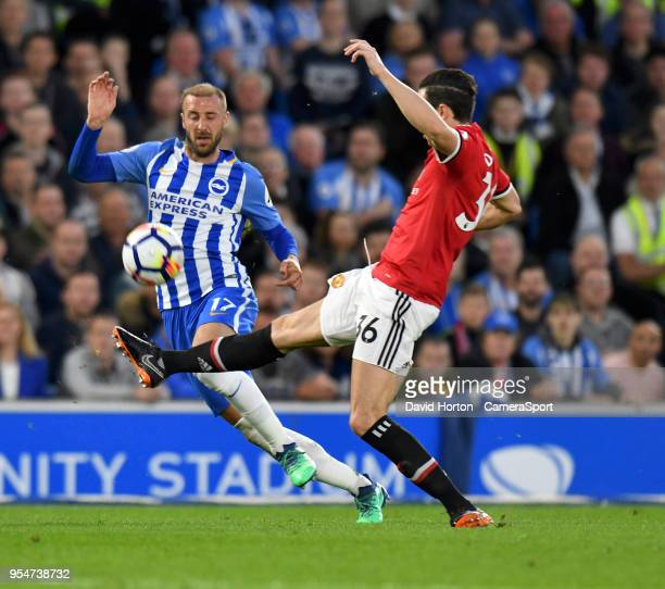 Brighton Hove Albion's Glenn Murray battles with Manchester United's Matteo Darmian during the Premier League match between Brighton and Hove Albion...