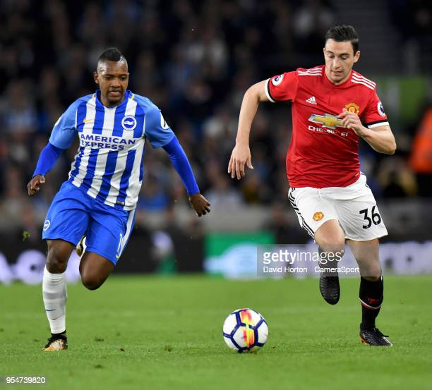 Brighton Hove Albion's Jose Izquierdo vies for possession with Manchester United's Matteo Darmian during the Premier League match between Brighton...