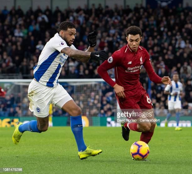 Brighton Hove Albion's Jurgen Locadiavies for possession with Liverpool's Trent AlexanderArnold during the Premier League match between Brighton Hove...