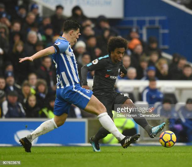 Brighton Hove Albion's Lewis Dunk battles with Chelsea's Willian during the Premier League match between Brighton and Hove Albion and Chelsea at Amex...