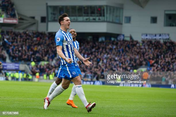 Brighton Hove Albion's Lewis Dunk celebrates scoring the opening goal during the Premier League match between Brighton and Hove Albion and Arsenal at...