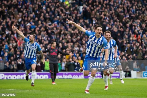 Brighton & Hove Albion's Lewis Dunk celebrates scoring the opening goal during the Premier League match between Brighton and Hove Albion and Arsenal...