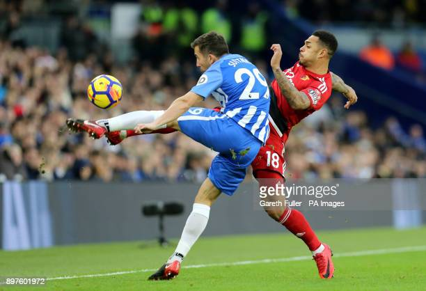 Brighton Hove Albion's Markus Suttner and Watford's Andre Gray battle for the ball during the Premier League match at the AMEX Stadium Brighton
