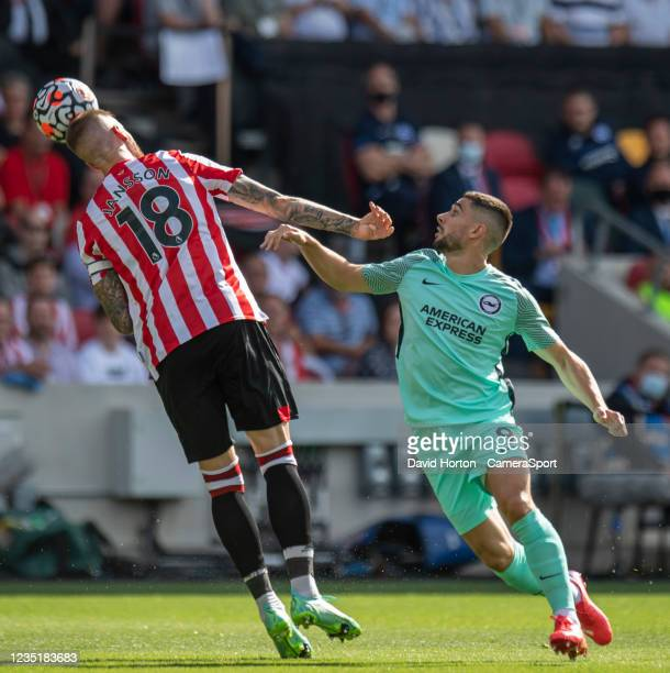 Brighton & Hove Albion's Neal Maupay battles with Brentford's Pontus Jansson during the Premier League match between Brentford and Brighton & Hove...