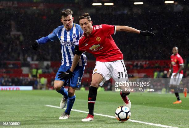 Brighton Hove Albion's Pascal Gross and Manchester United's Nemanja Matic battle for the ball during the Emirates FA Cup quarter final match at Old...