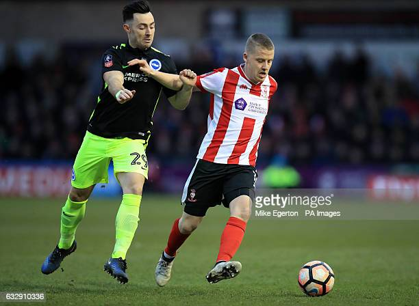 Brighton Hove Albion's Richie Towell and Lincoln City's Terry Hawkridge battle for the ball during the Emirates FA Cup fourth round match at Sincil...