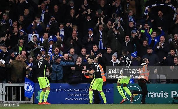 Brighton Hove Albion's Richie Towell celebrates scoring his sides opening goal during the Emirates FA Cup fourth round match at Sincil Bank Lincoln