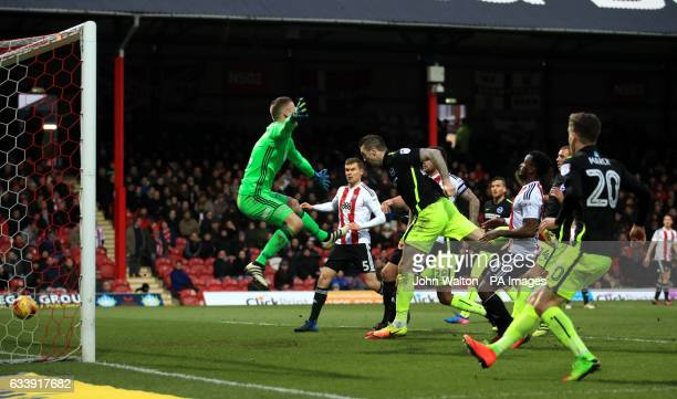 Brighton Hove Albion's Shane Duffy scores his side's second goal of the game during the Sky Bet Championship match at Griffin Park London