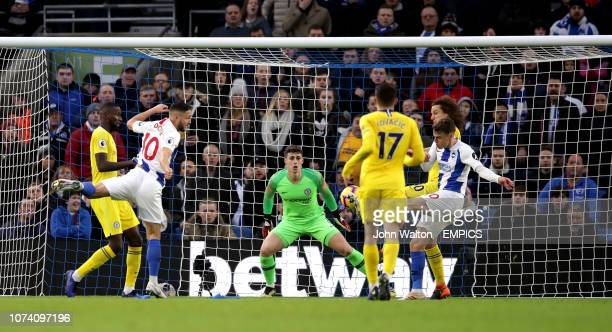 Brighton Hove Albion's Solly March scores his side's first goal of the game as Chelsea goalkeeper Kepa Arrizabalaga looks on Brighton Hove Albion v...