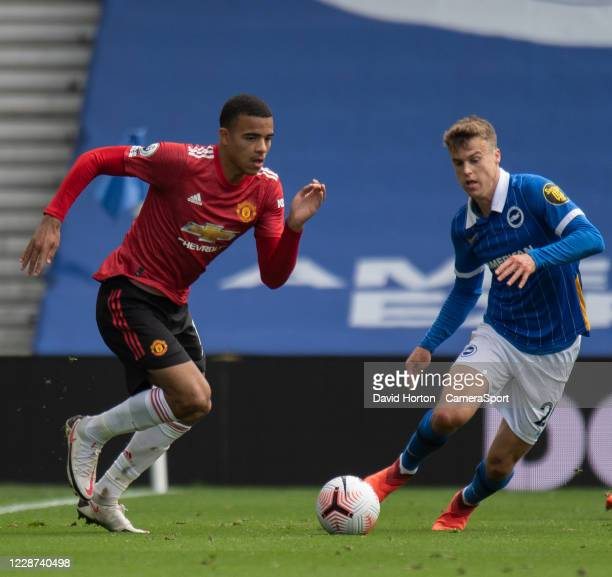 Brighton Hove Albion's Solly March under pressure from Manchester United's Mason Greenwood during the Premier League match between Brighton Hove...