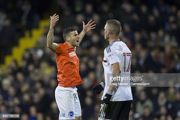 Brighton Hove Albion's Tomer Hemed celebrates scoring his sides first goal from the penalty spot during the Sky Bet Championship match between Fulham...