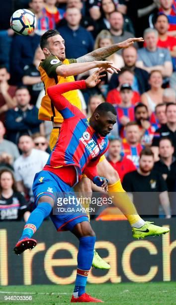 Brighton Irish defender Shane Duffy rises above Crystal Palace's Zaireborn Belgian striker Christian Benteke during the English Premier League...