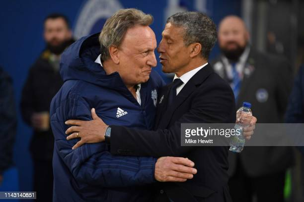 Brighton manager Chris Hughton greets Cardiff manager Neil Warnock ahead of the Premier League match between Brighton Hove Albion and Cardiff City at...