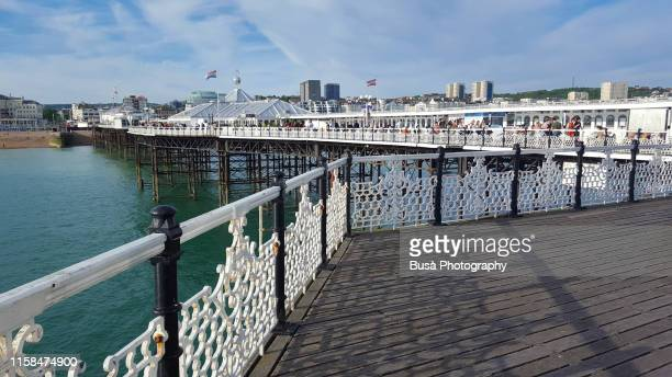 brighton palace pier, famous pleasure pier in brighton, england - pier stock pictures, royalty-free photos & images
